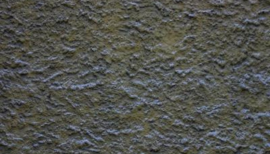 A slightly textured stucco application helps disguise boring concrete retaining walls.