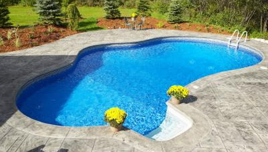 A Hayward Navigator vacuum keeps an in-ground pool clean.