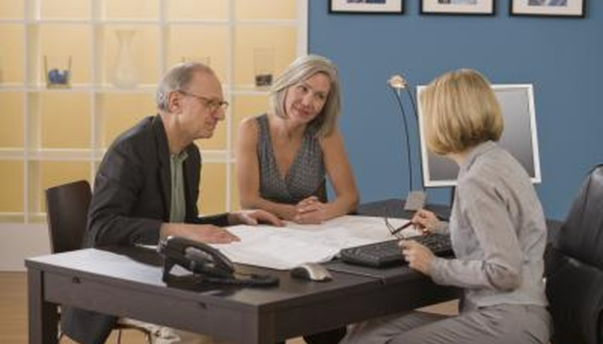 A couple consults with an attorney.
