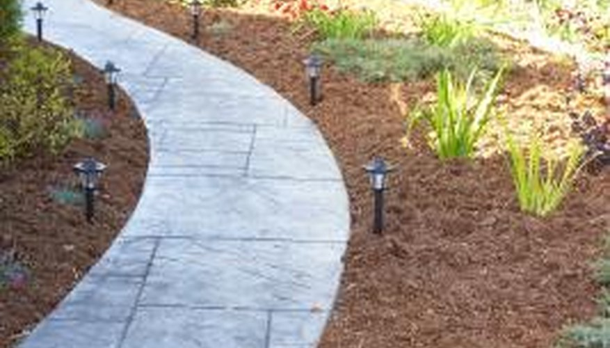 Installing flower beds alongside a walkway can improve your yard's appearance.