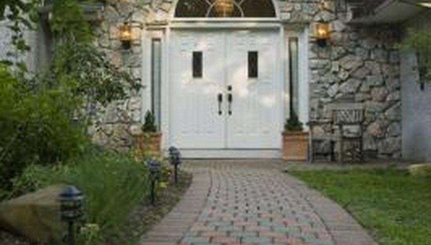 Alternating two colors of pavers adds visual interest to a walkway.