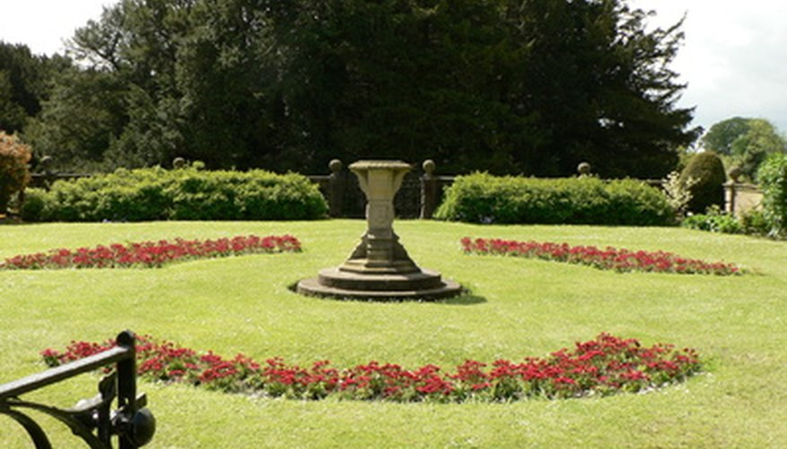 Flowers, hedges and trees in a formal garden.