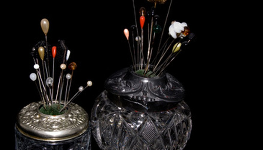 Victorian hat pin holders were often made of cut glass.