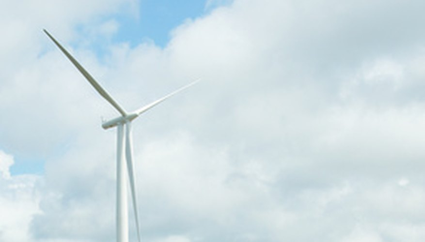 Wind turbines generate electricity when wind moves the rotors.