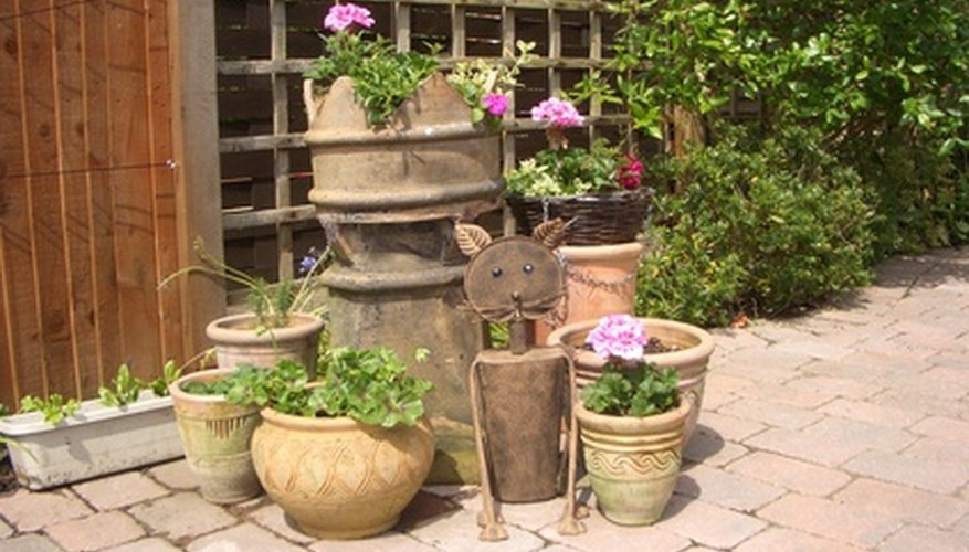 Potted flowering plants add to patio decor.