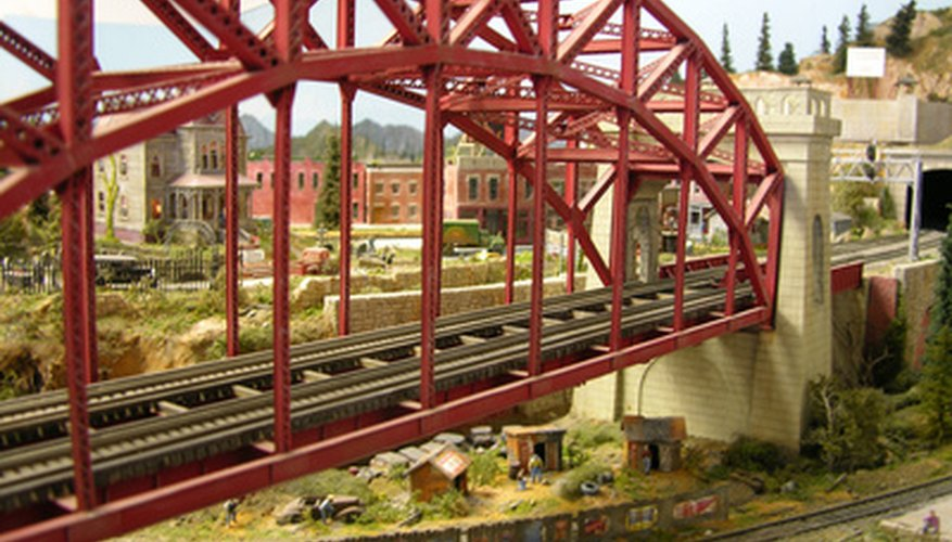 Model railroad bridge placed over  a second track.