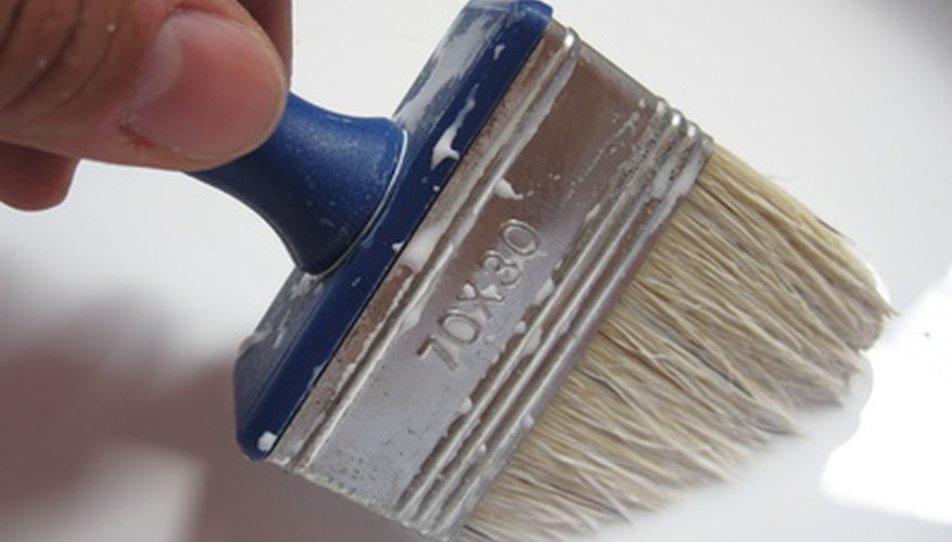 Use long, even brush strokes to paint hardboard.