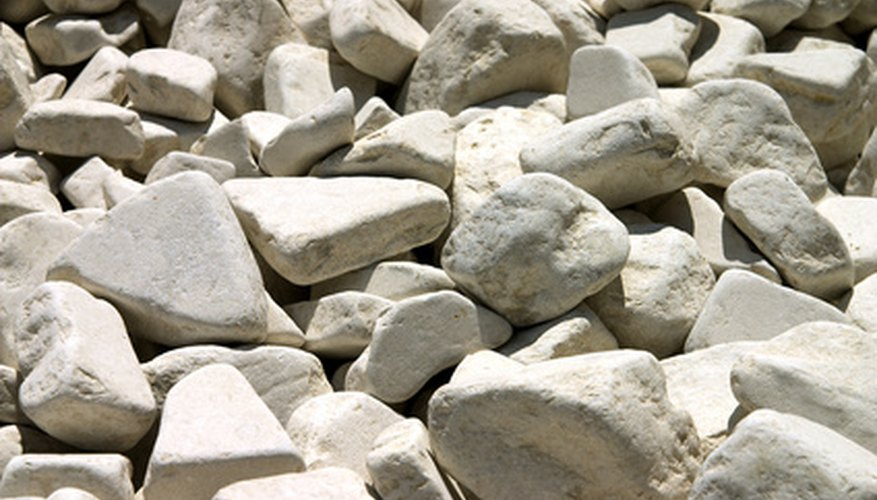 Landscaping with white rocks can enhance your flower bed.
