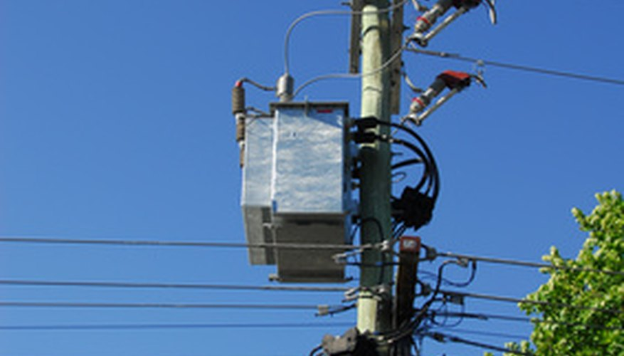 Electrical and communication wires are arranged on an electrical pole in hierarchical zones.
