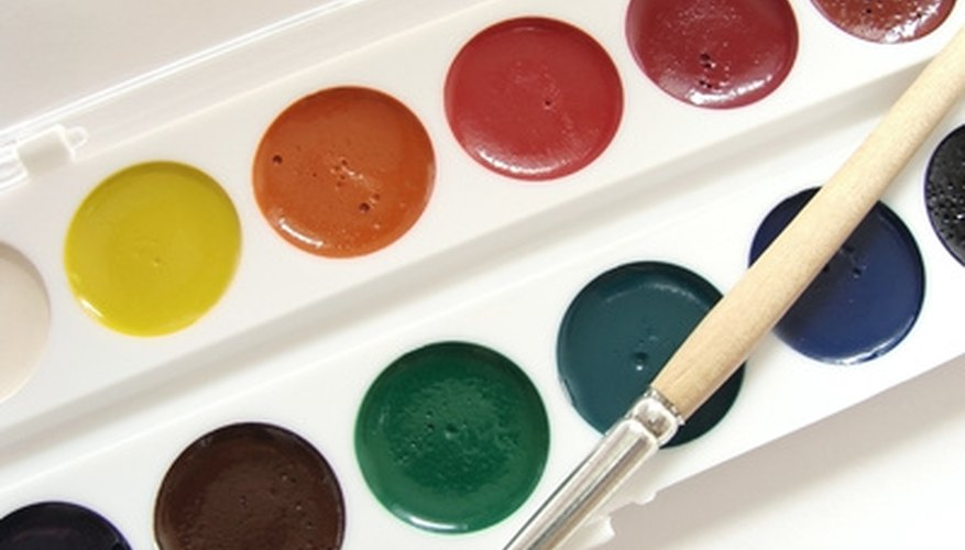 A classic case of pan watercolors with brush.