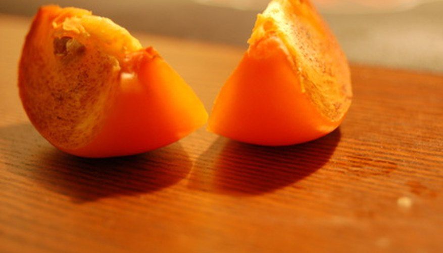 An Oriental persimmon tastes great when picked fresh off the tree.