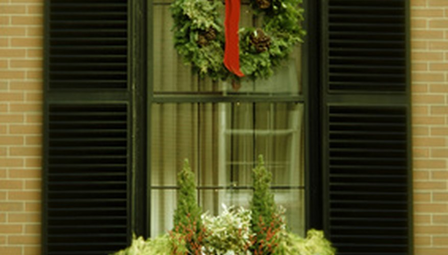 Old-fashioned evergreen wreaths are traditional crafted Christmas decorations.