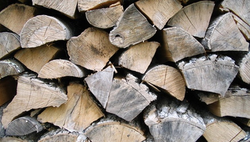 Log racks can help firewood stay neatly stacked.