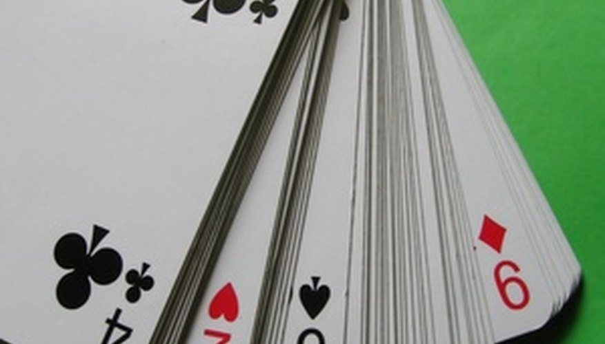Regular solitaire is played with a standard, 52 card deck of playing cards.