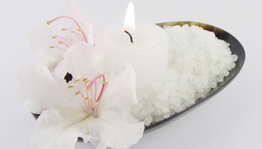 Arrange elegant flowers and a candle on a simple silver tray.