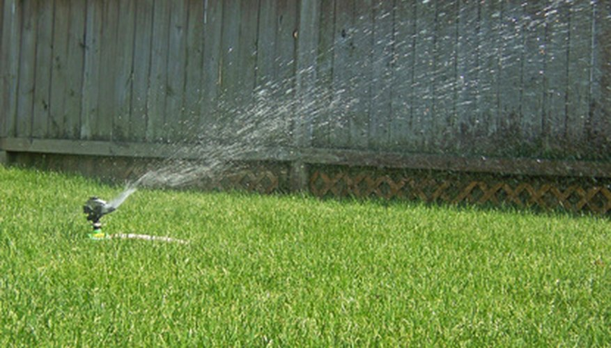 Elevating a lawn sprinkler will propel water over tall plants.