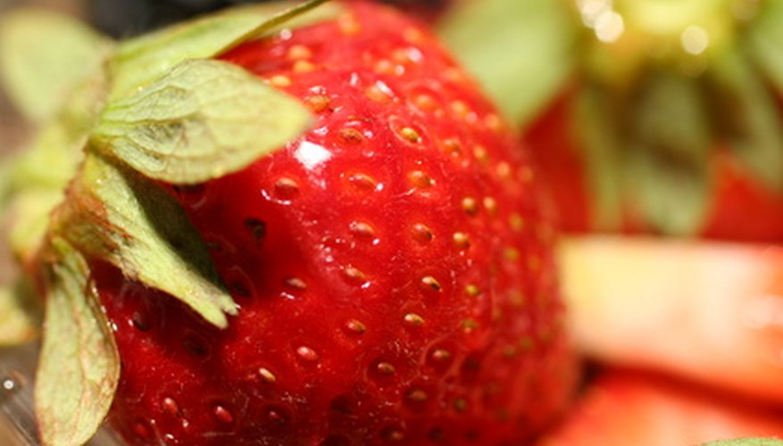 Strawberry plants provide delicious summer fruits.