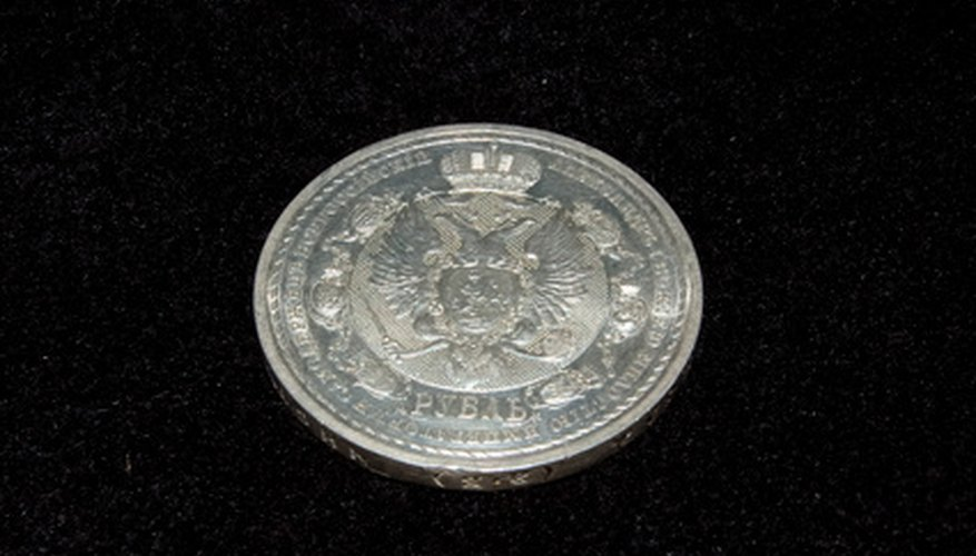 Silver coins can become bright and shiny with the use of baking soda.