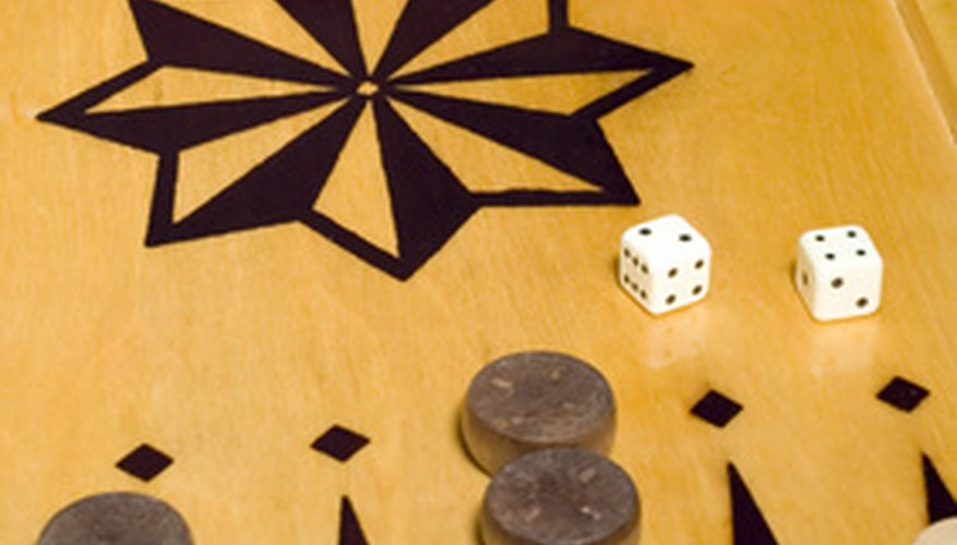 Acey-Duecy is played on a backgammon board.A backgammon game in progress.