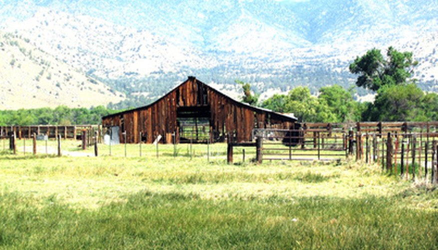 Emulate this rustic wood and wide expanse of grass in your ranch landscape.