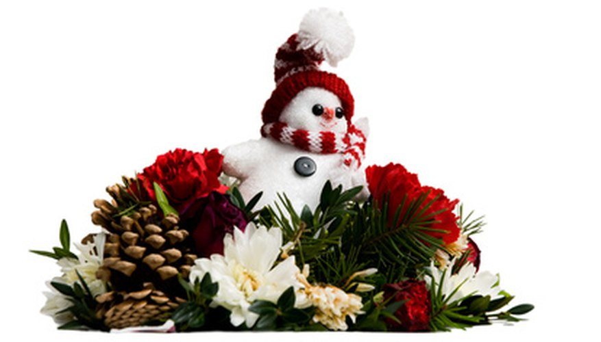 A Christmas floral arrangement is pleasing to children and adults.