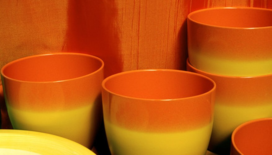 Plastic pots can be weathered or painted for an aged look.