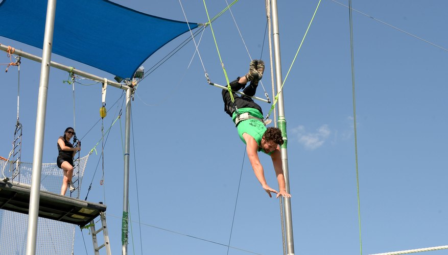 A visitor practicing trapeze at Trapeze School New York.