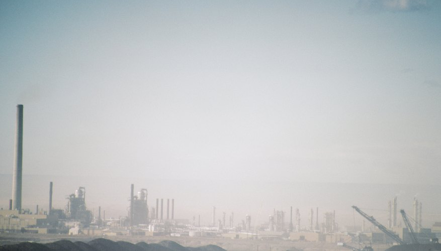 Smog settles over an industrial park.
