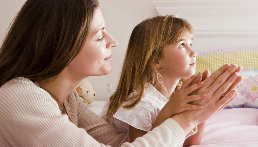 Pray with your child while teaching the Lord's Prayer.