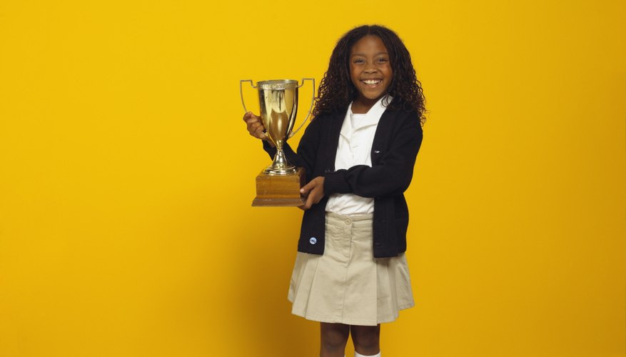 Student winning trophy at a science fair