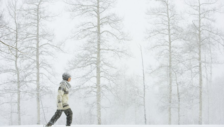 Woman walking in snow.