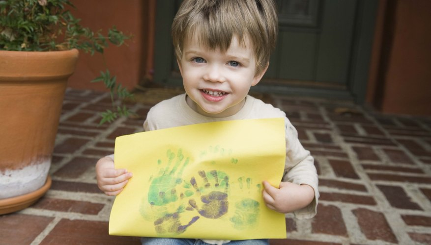 Toddlers enjoy the messy, creative art of painting.