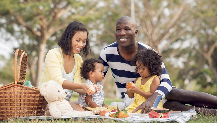 Happy blended family having picnic together