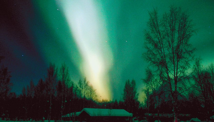 Auroras occur when the solar wind collides with Earth's atmosphere.