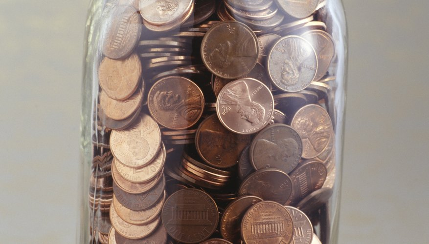 Pennies oxidize as they age, giving them a dull brown color.