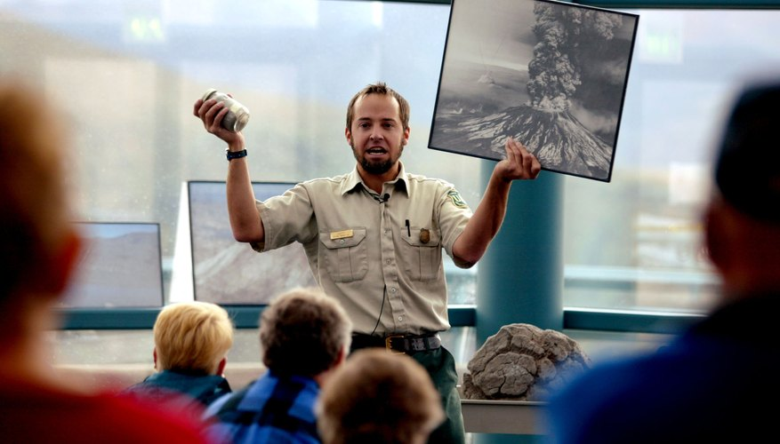 A guide holds up a photo from the 1980 eruption of Mt. St. Helen's