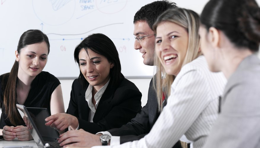Business colleagues laughing in meeting