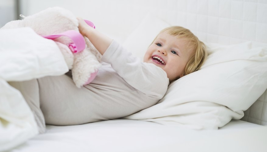 Toddler lying in bed