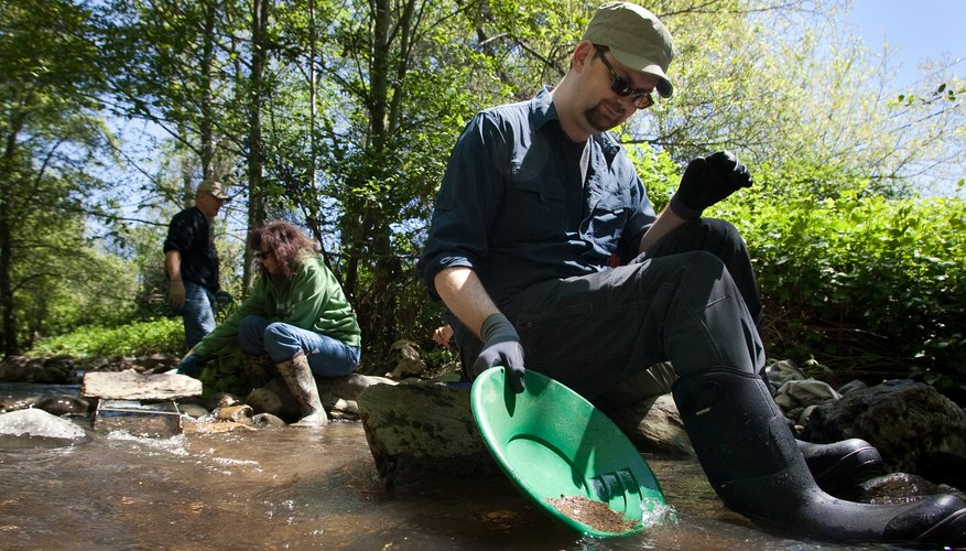 People pan for gold in streams in California's gold country.