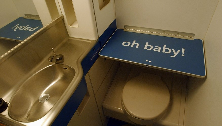 Most airplanes have baby changing tables in the restrooms.