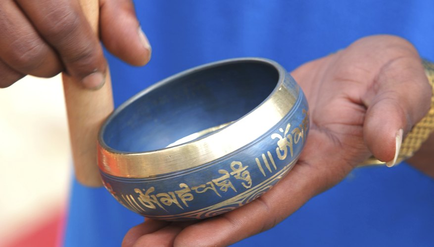 A singing bowl produces sound Energy.