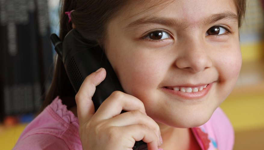 Children often possess a strong curiosity about talking on the telephone and answering the front door.