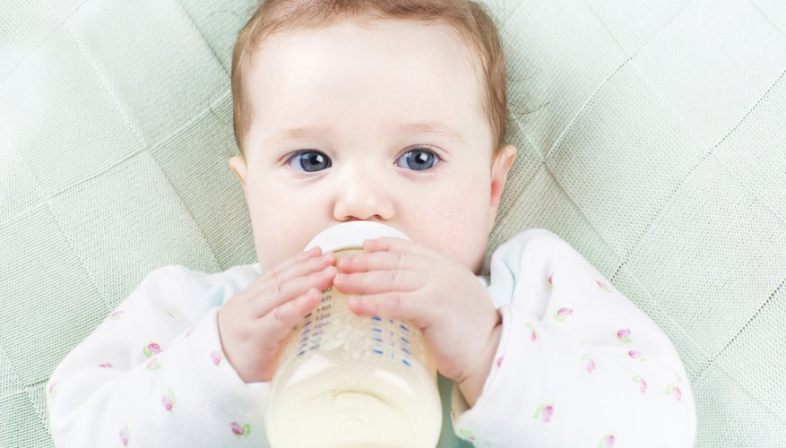 Baby drinking formula from bottle