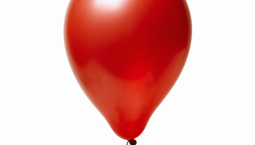 The balloon helps keep the gas in one place instead of dispersing in the air.