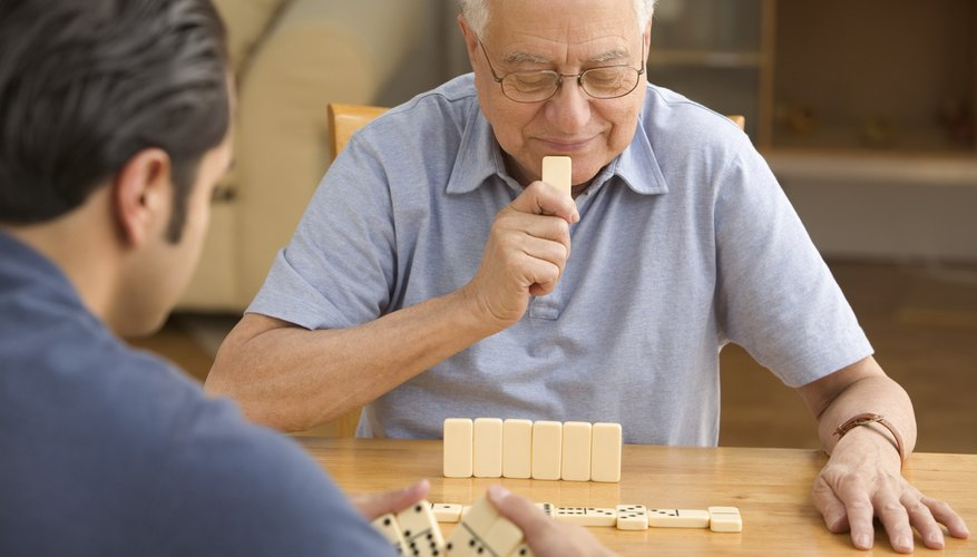 Keep the blank sides of your dominoes to your opponent to hide your hand.