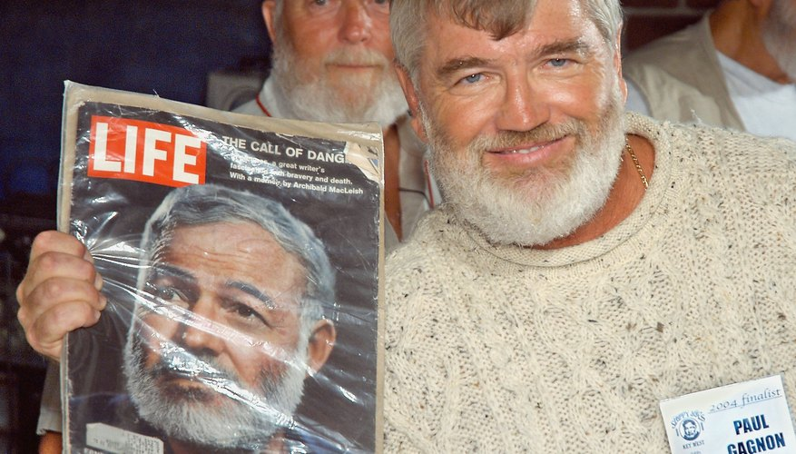 Life magazine from 1961 featuring Ernest Hemingway, held by a look alike contestant