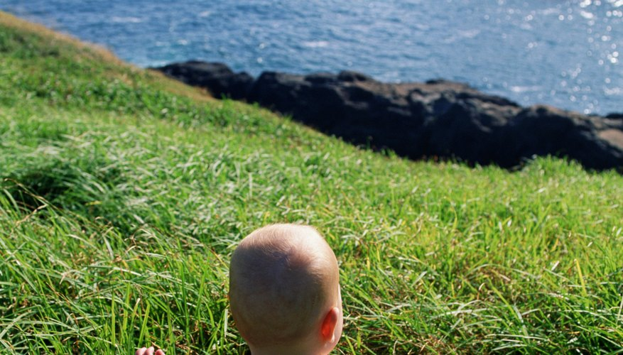 Simply feeling the grass is a tactile experience for your baby.