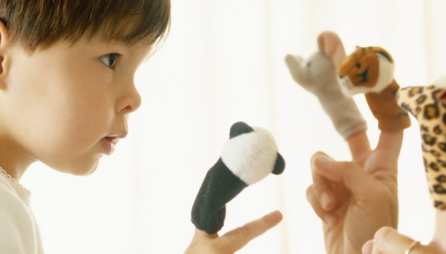 Finger puppets and hand puppets work well for fostering his development.