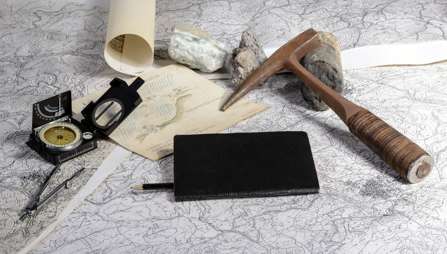 Geographical research tools on a topography map.