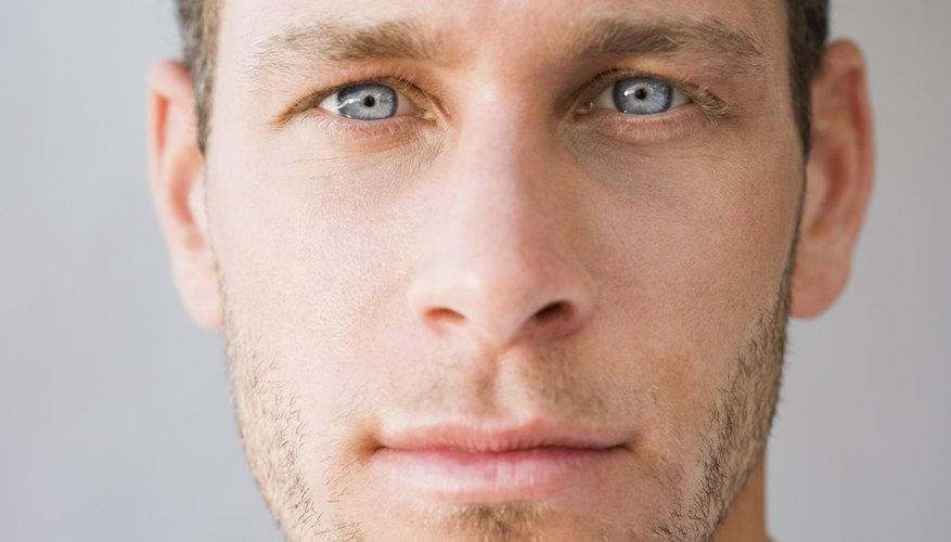 A close up of a mans face.